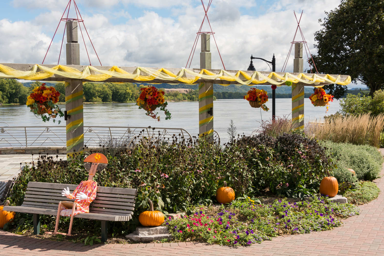 Fall display next to sculpture at riverfront