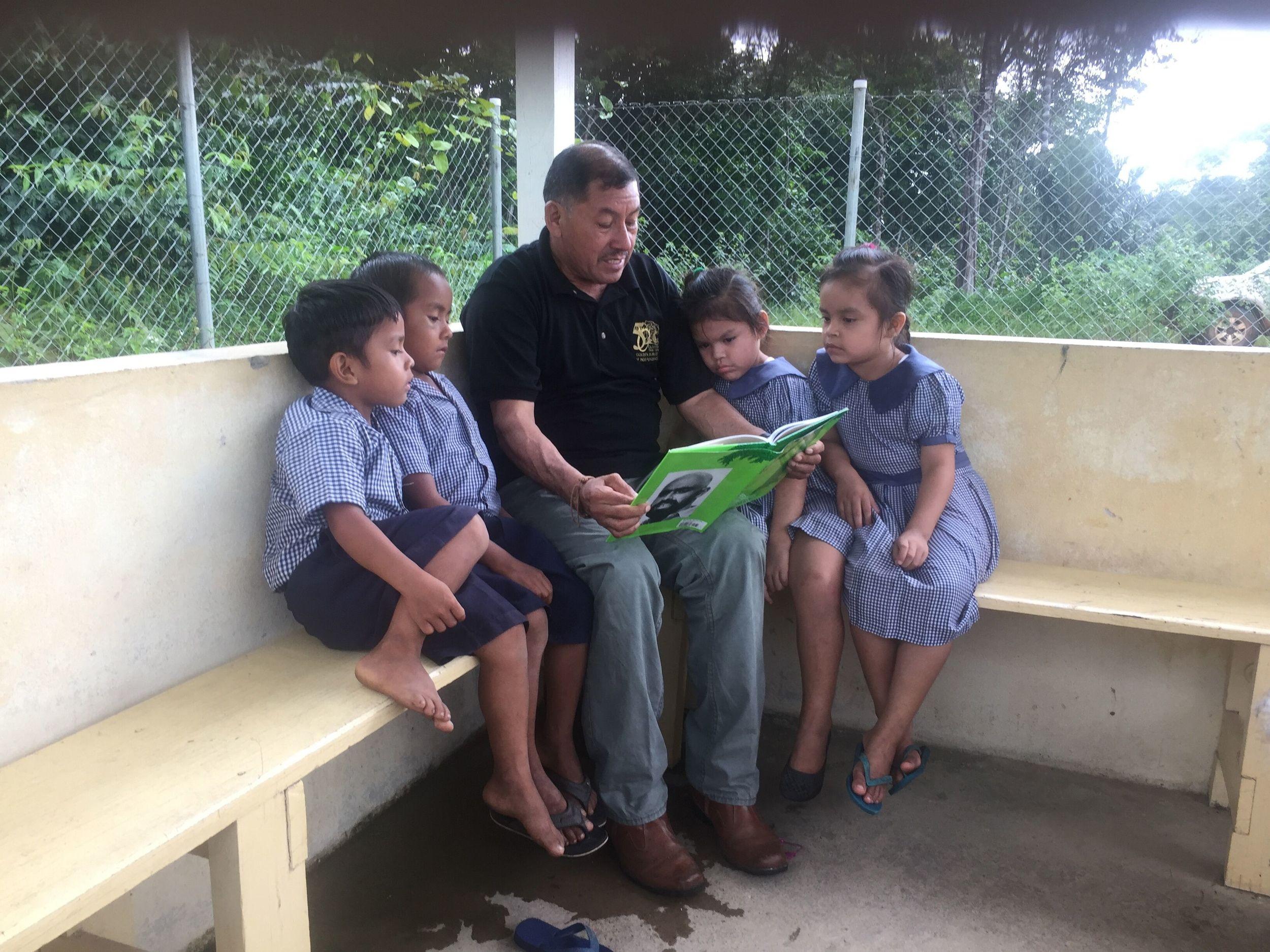 VP Sydney Allicock reading to children