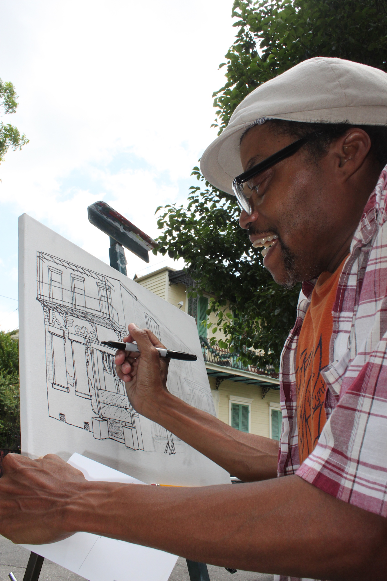 "Keith Duncan; Photography by H. Hickman  In May 2015, local artists Katrina Andry, Ron Bechet, Amy Bryant, Jer'Lisa Devezin, Keith Duncan, Horton Humble, and Varion Laurent engaged in a ""Live Action Painting"" of portraits of blighted houses. This quiet event unfurled without PR attention—it was a humble opportunity for artists to engage in dialogue with residents and meditate on the sensory experience of blight. The event took place soon after the City of New Orleans placed several hundred blighted properties up for auction; housing rights advocates and neighbors alike feared that the auction would lead to a land grab and bloodletting of rapidly gentrifying neighborhoods like New Orleans' historic 6th Ward. Residents reported non-local white folks ""swarming"" the neighborhood with cameras. Blights Out was interested in carefully navigating the delicate situation, strategically bringing only local Black artists to paint plein air and engage in candid conversation about the changing neighborhood. The decision to invite only Black artists was controversial amongst our participants and generated a meaningful discussion about race relations, gentrification, and public perception."