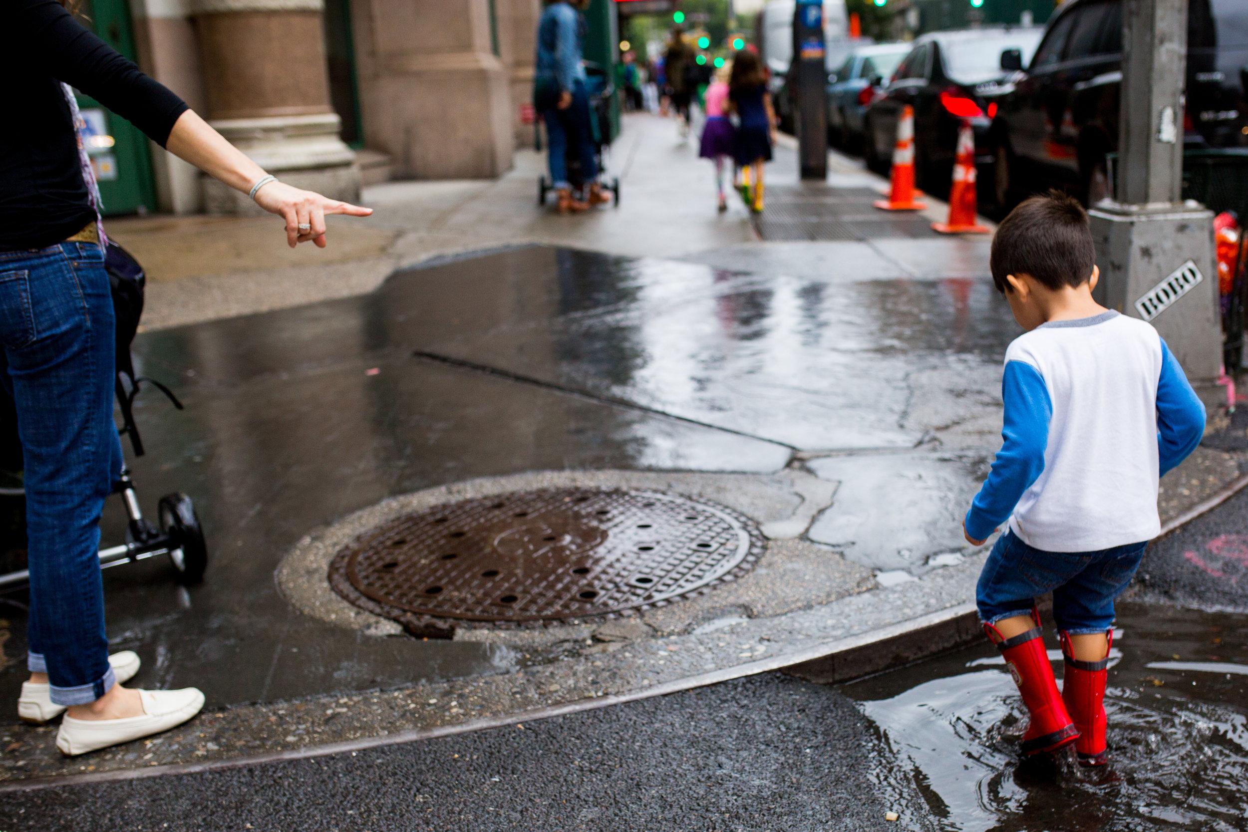 Boy in a rain puddle