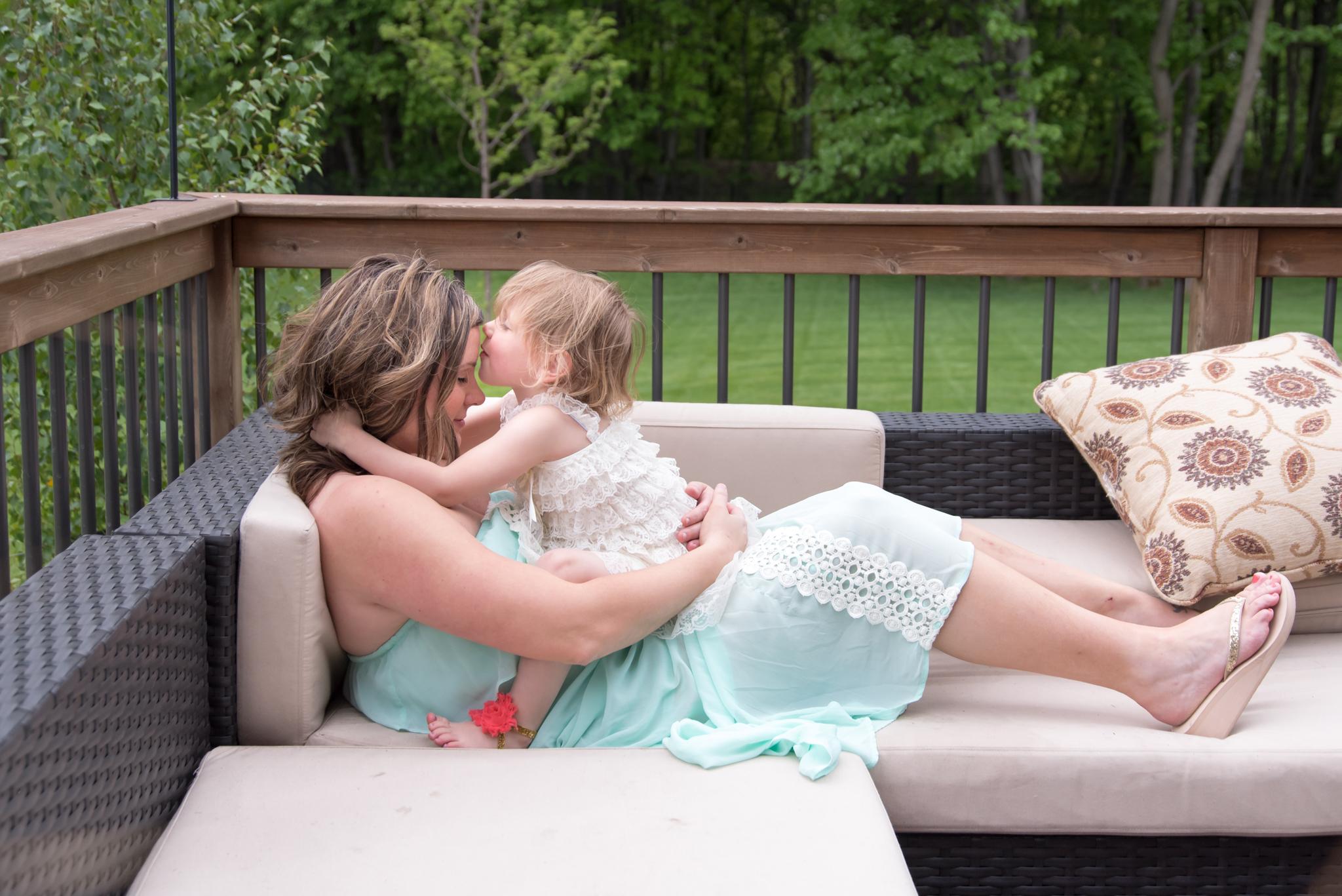 girl kissing mom