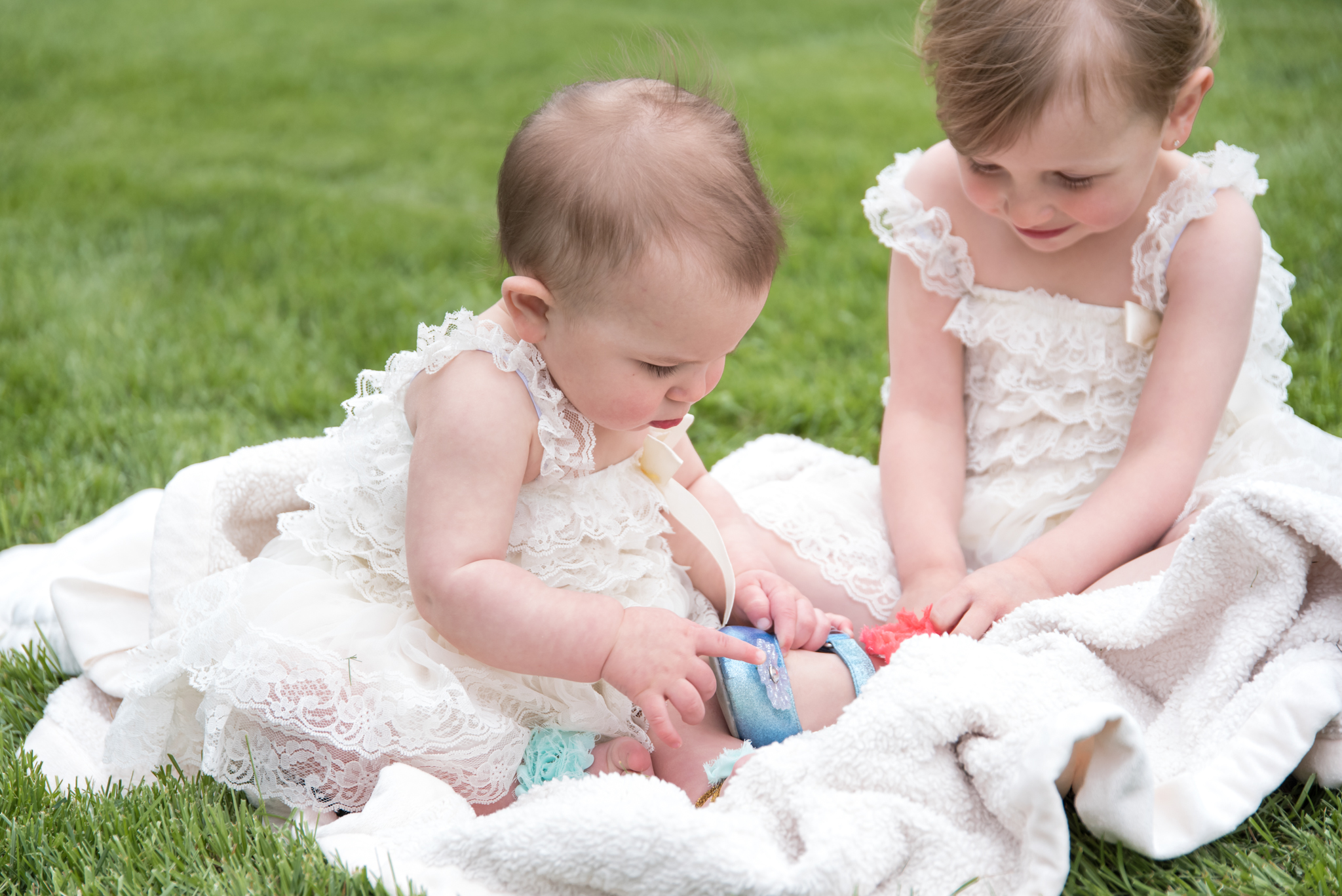 Infant wonderment with siblings shoes