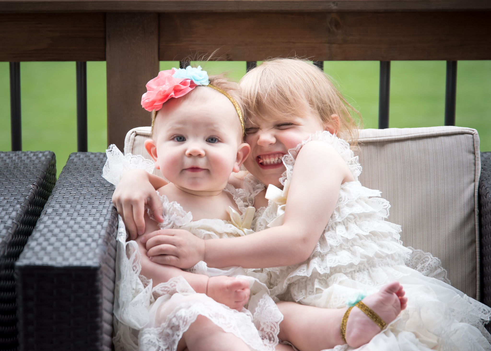 Two girl siblings hugging