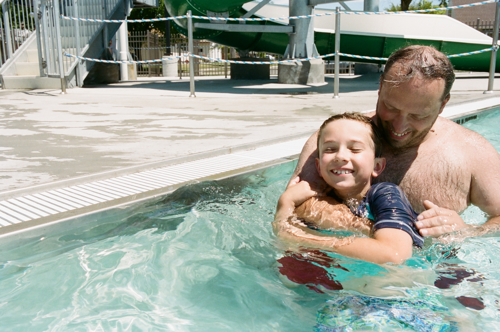 Boy and Dad in Pool