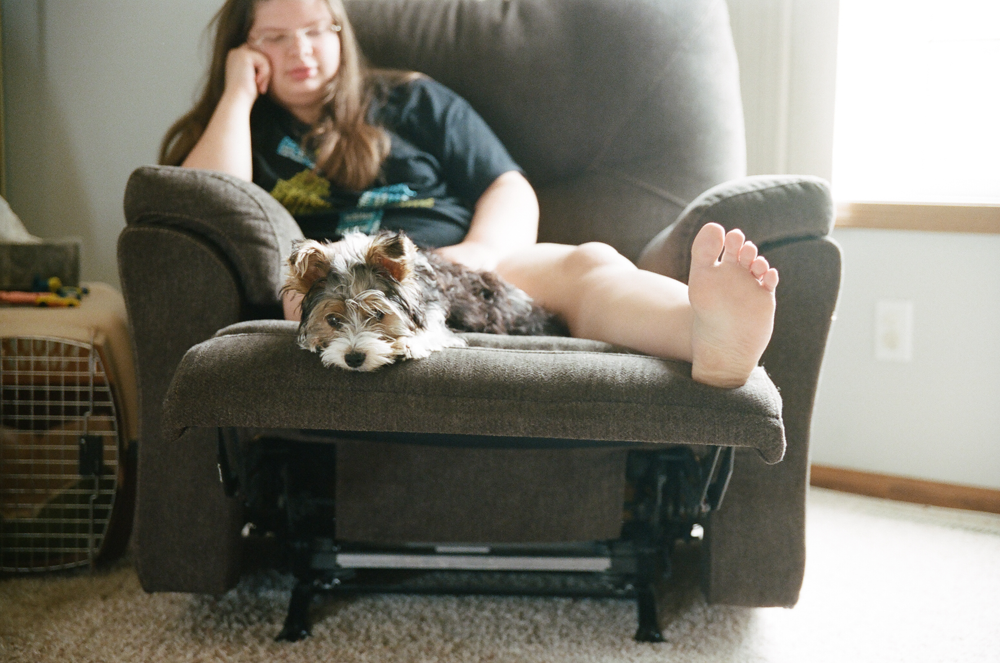 Girl and puppy relaxing