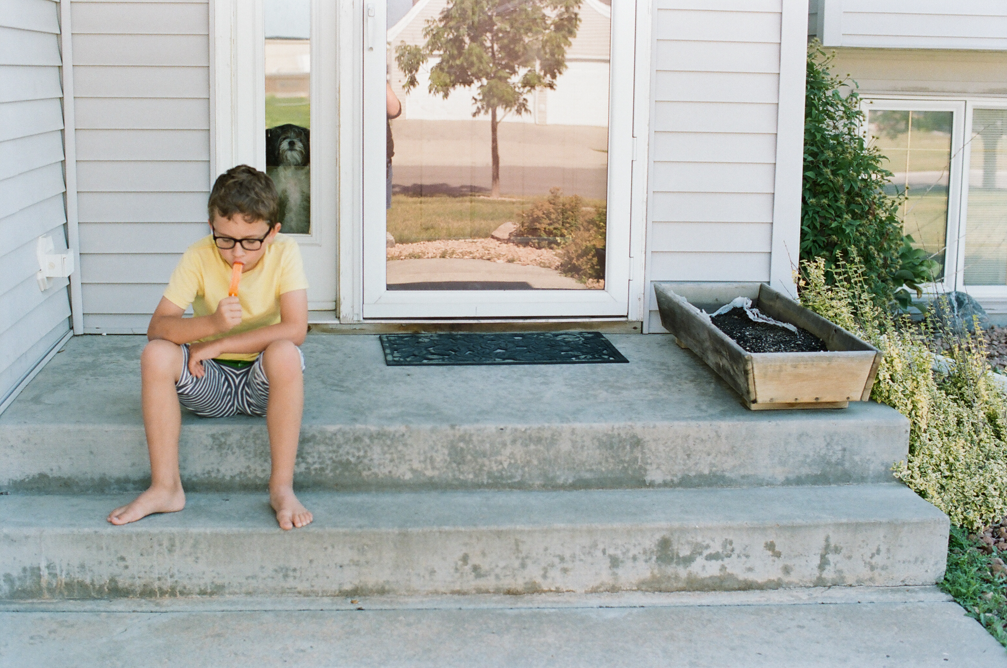 Boy on front step