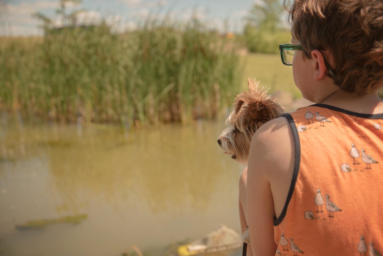 Boy-dog-pond-west-fargo