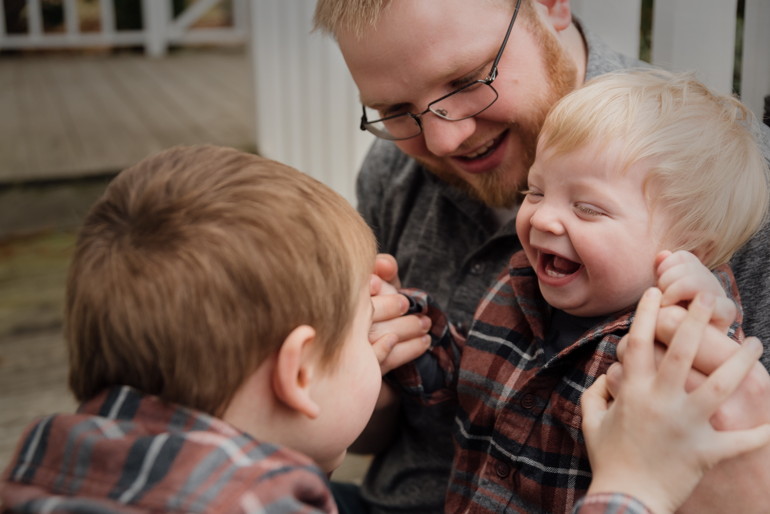 A Dad and his boys laughing and playing during a session in Texas.