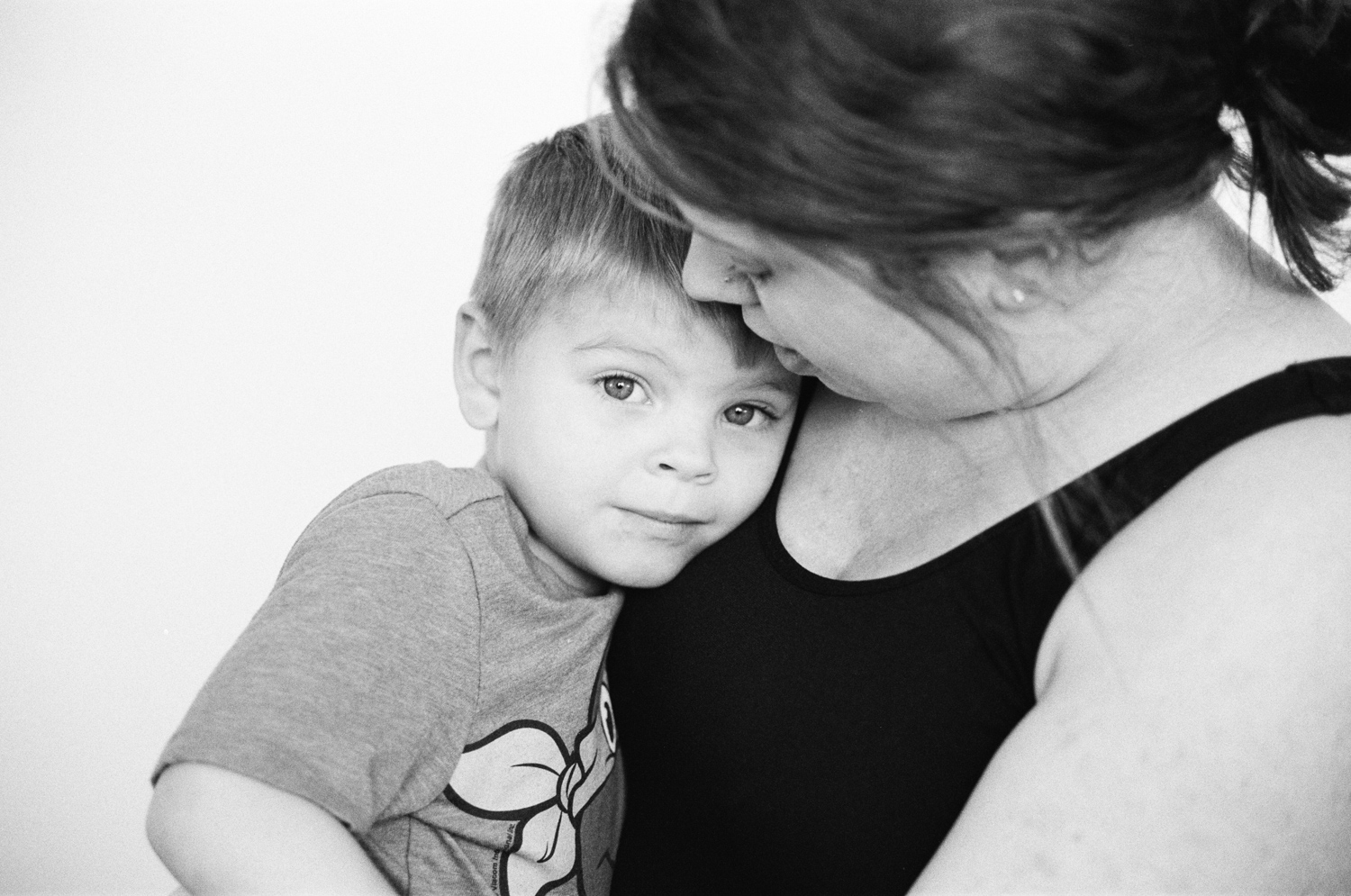 Portrait of mom and son hugging.
