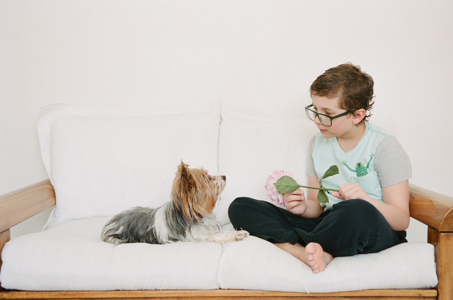 Picture of a boy with his yorkie taken in the spring.