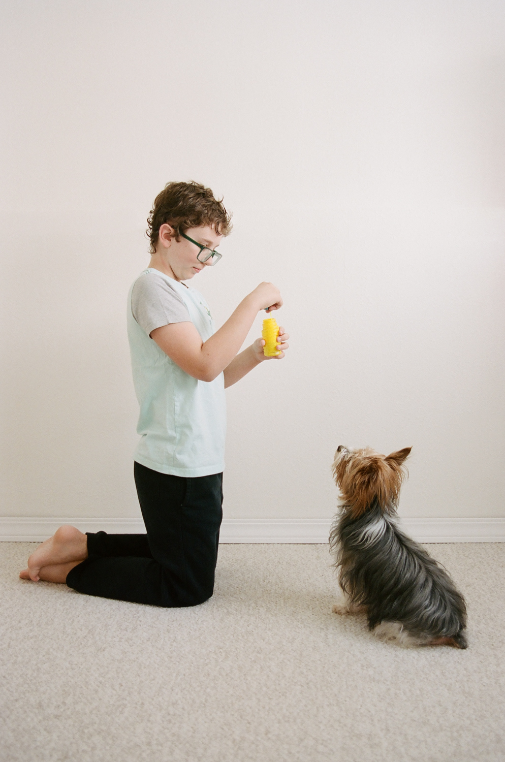 Portrait of a boy with his yorkie who loves bubbles.