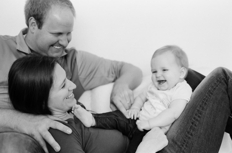 Unposed family portrait showing joy.