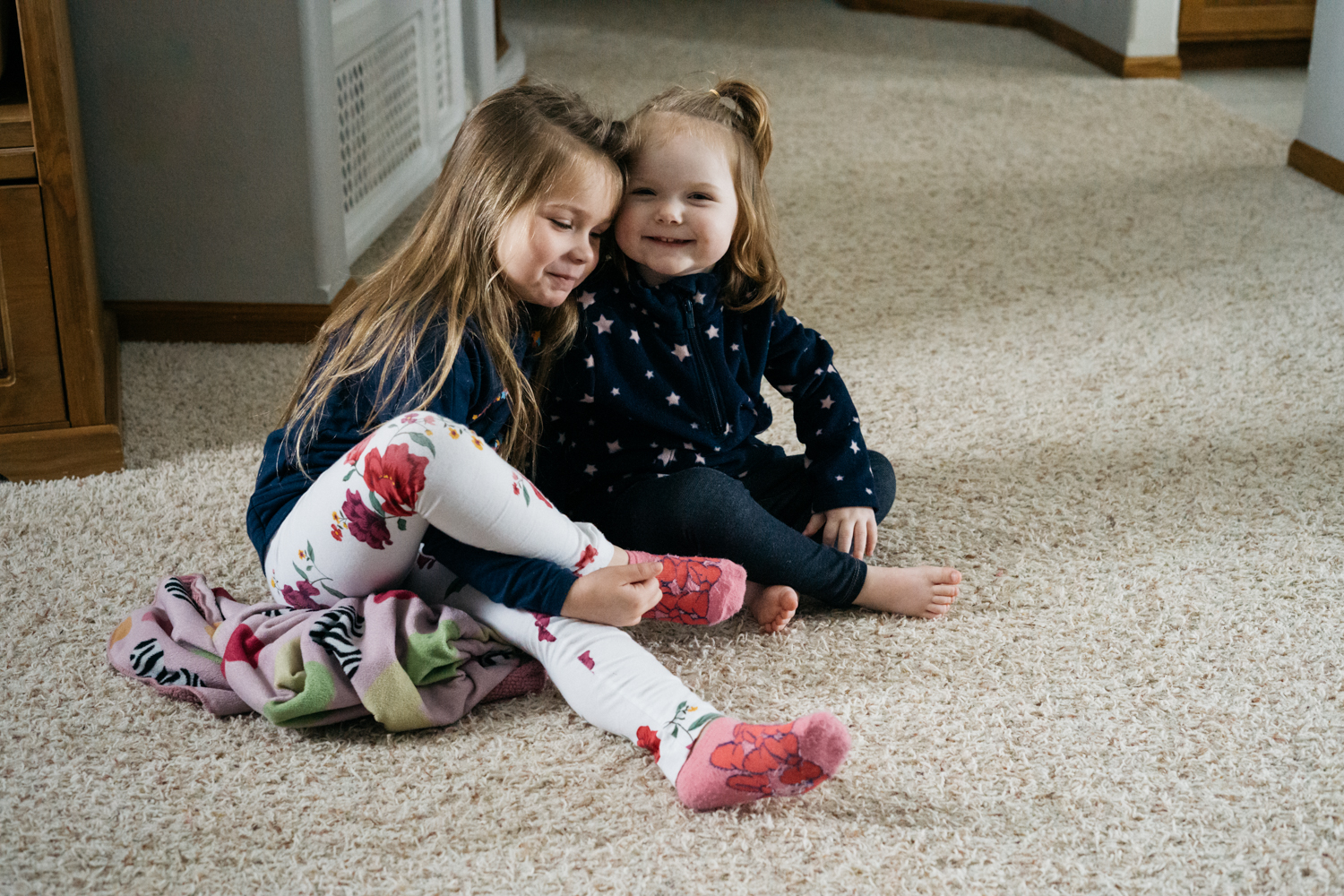 Two little girls sharing a moment of friendship at a West Fargo preschool daycare.