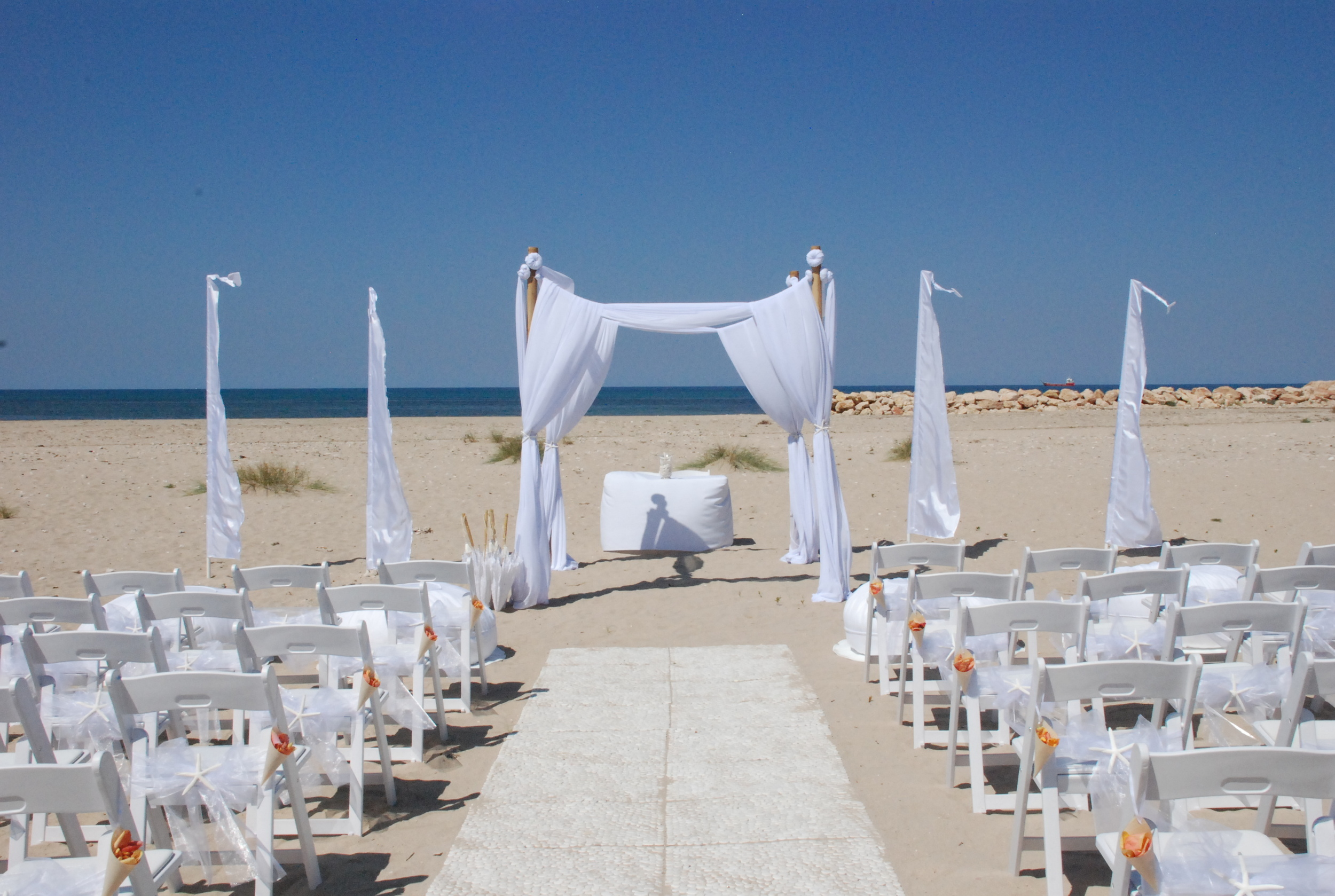 Bamboo Structure with White Drapes, Bali Flags, Pebble Matting Aisle & Gladiator Chairs