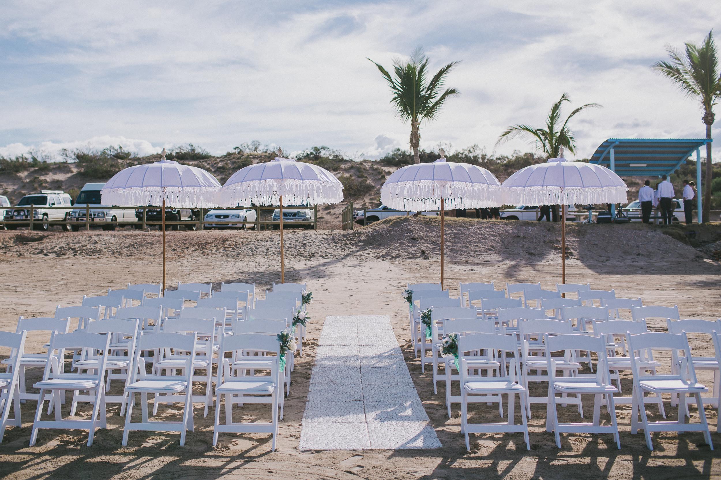 Pebble Matting Aisle, Gladiator Chairs & Bohemian Umbrellas