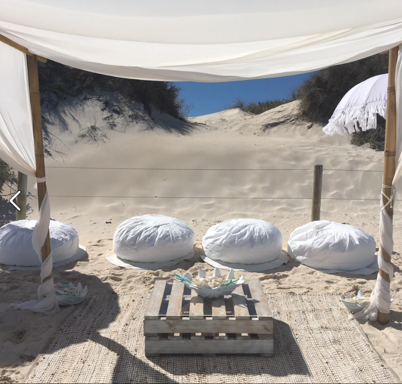 Ottomens, Pellet Table, Rug, Large Clam with Shells & Starfish. Image Courtesy: Hilary Van Eldik Marriage Celebrant Ottomans, White Washed Pellets