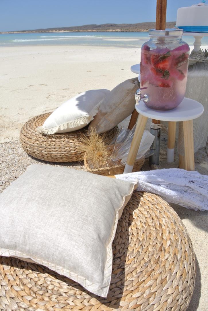 Natural Woven Ottomans, Cushions Bohemein Umbrella, Table & Drink Station