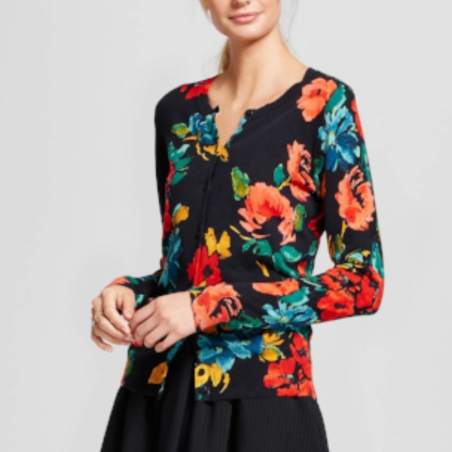 I got a similar item from a friend who was cleaning out her closet. I needed a punch of color - something that just made me feel happy! I pair this with my black/white thin stripe blouse underneath.