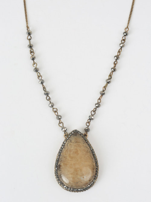 This necklace hits me just below my sternum which is the perfect length for a statement piece.