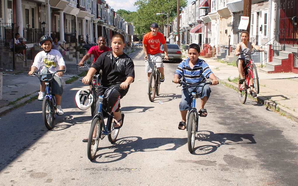 Simple Cycle's Owner, Daniel with Youth