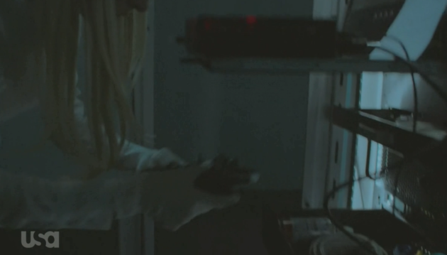 Figure 5: Angela finds Remote PED, with the black iKey already plugged in.  (USA Network)