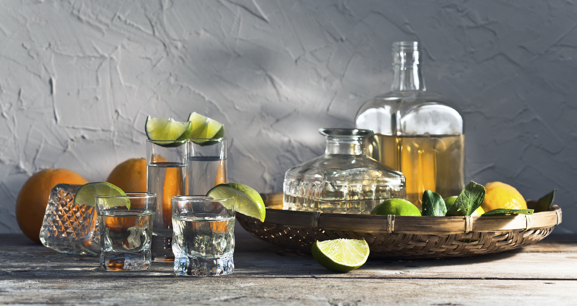 Tequila Bar with various types of tequilas and garnishes for guests to try - lemons, limes, oranges, and grapefruits + salt/sugar + fresh juices [grapefruit, pineapple, etc..]