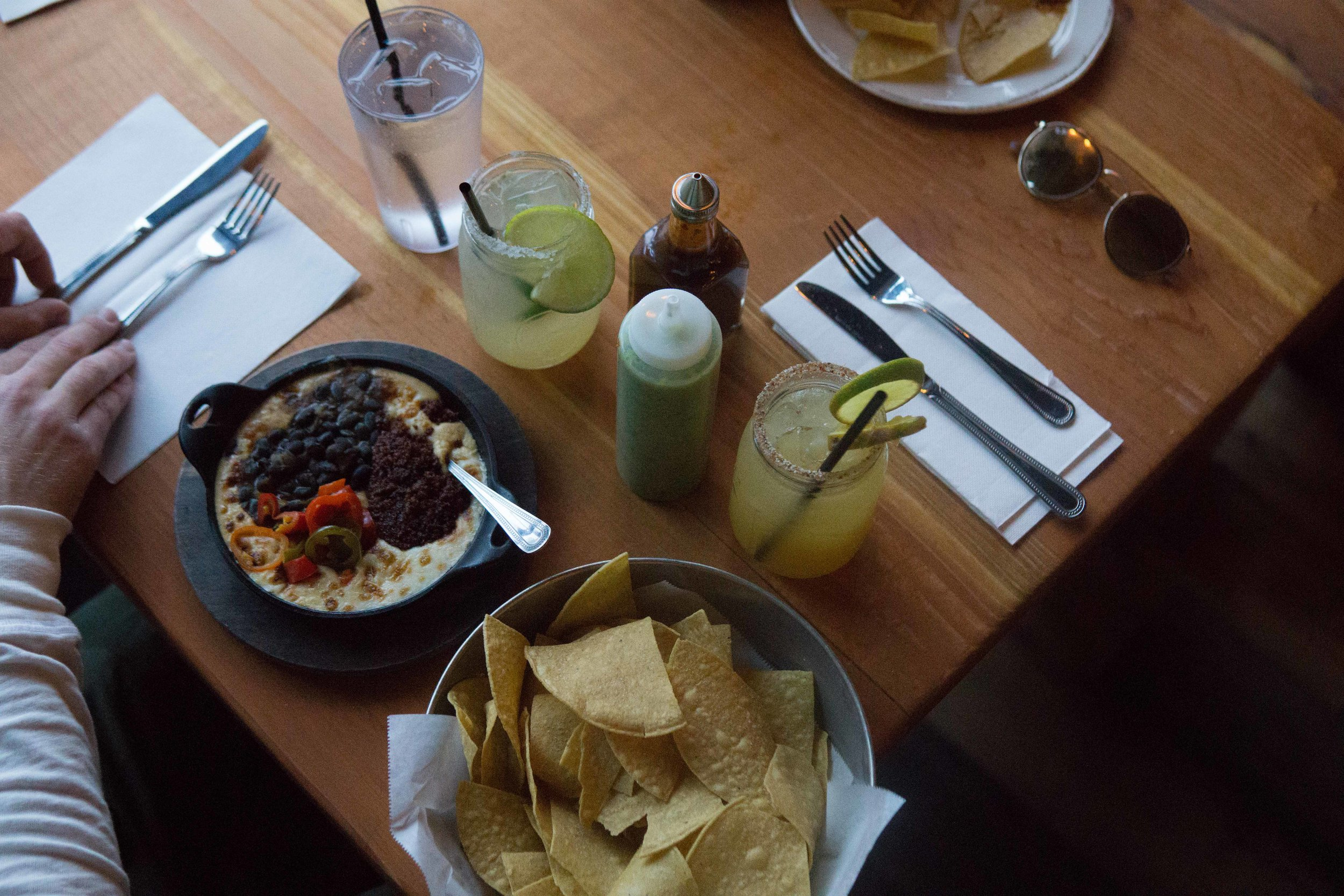 Chips and queso loaded with every accompaniment they offer. Best washed down with the Bakersfield Marg (spicy).