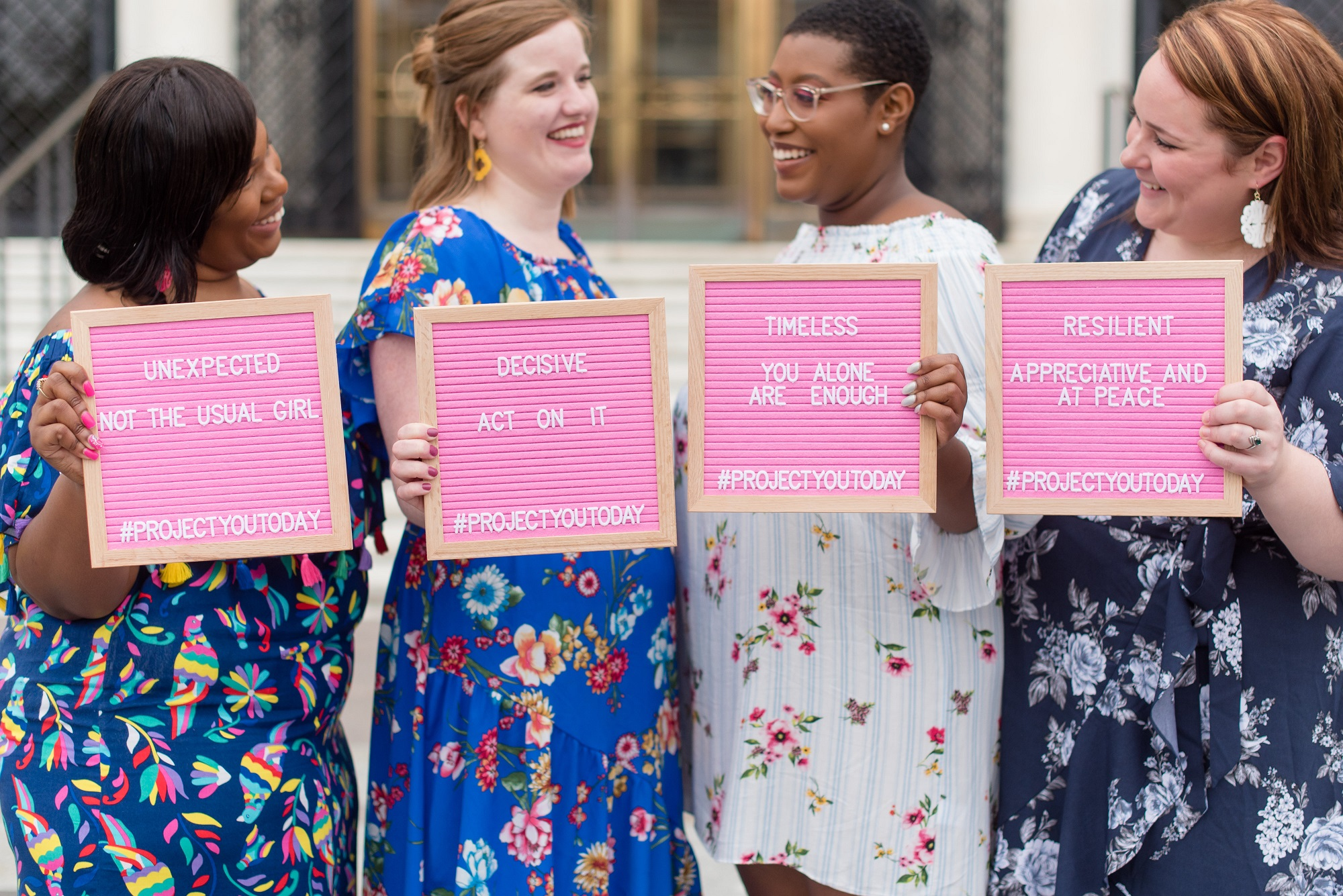 Inspiring, well-dressed women with pink signs are forces to be reckoned with. Photo via Jennifer Boris Photography