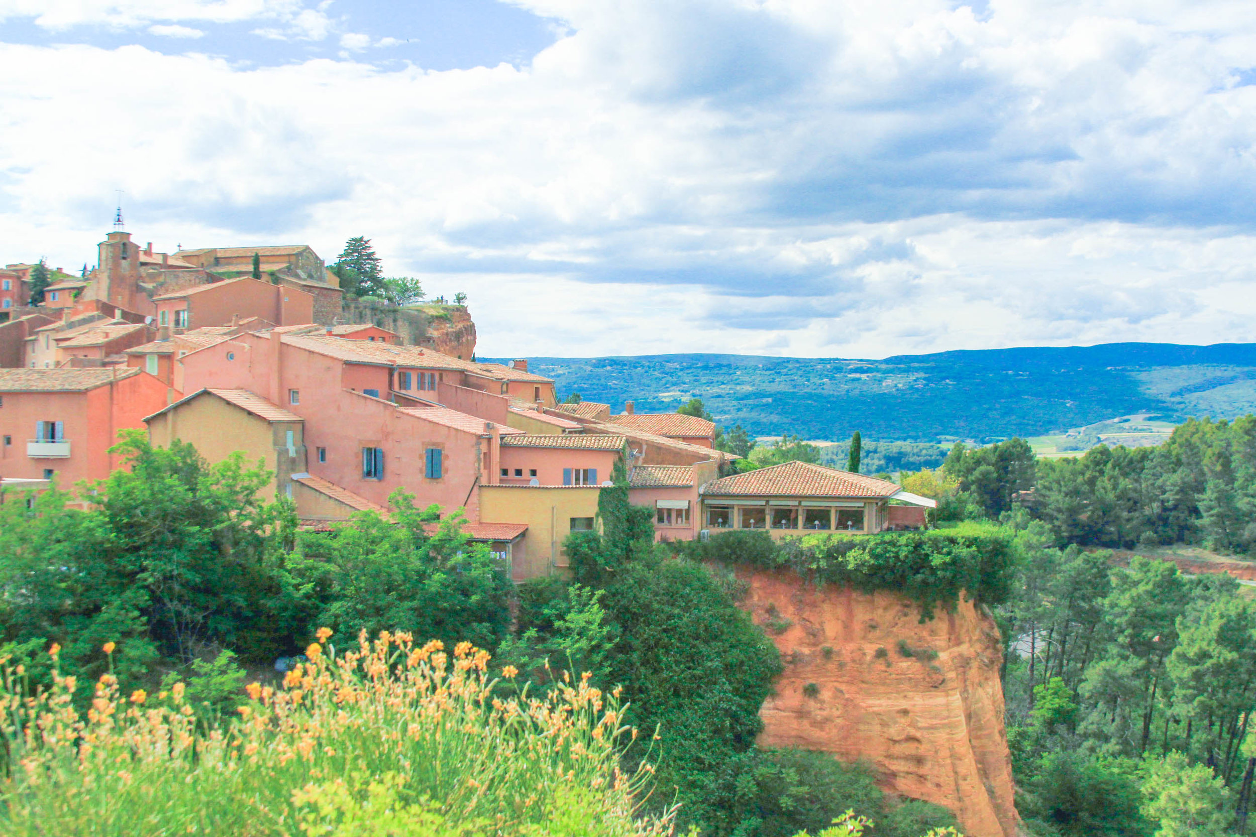 """Roussillon, France is built on top of a striking red-ochre cliff...."" 
