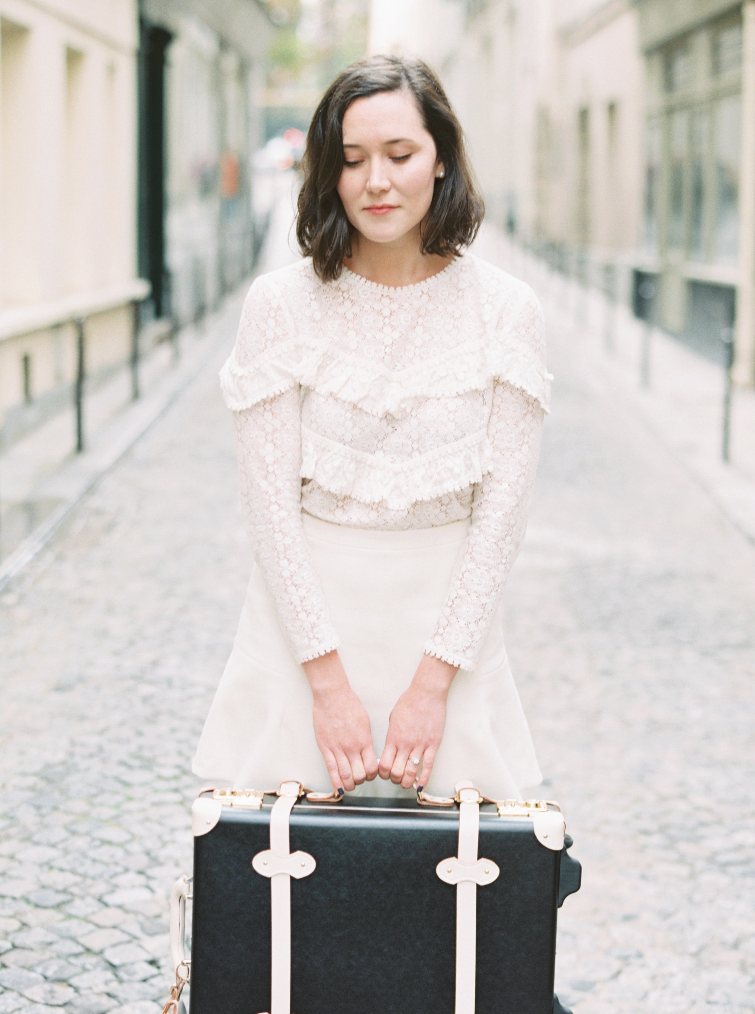 photo by     Molly Carr Photography    Sézane   top  , J. Crew skirt (old,   similar  ), Steamline luggage (last season, smaller case on sale   here  , similar   here  , similar on sale   here  ).