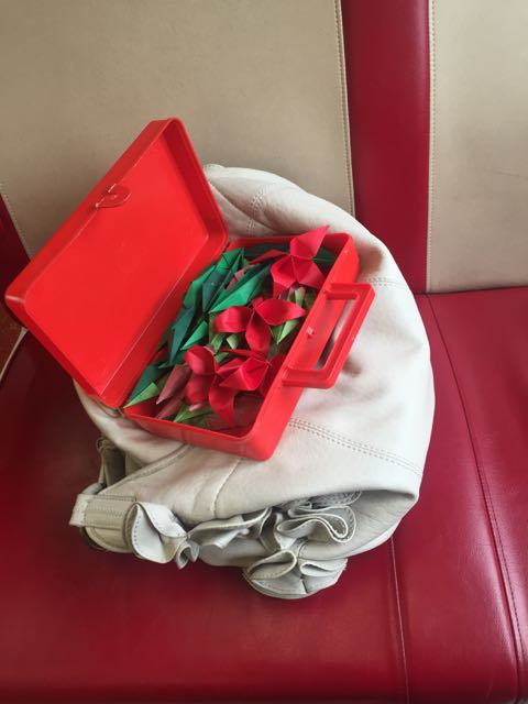 My little red box in the train - filled with paper - flowers in the making