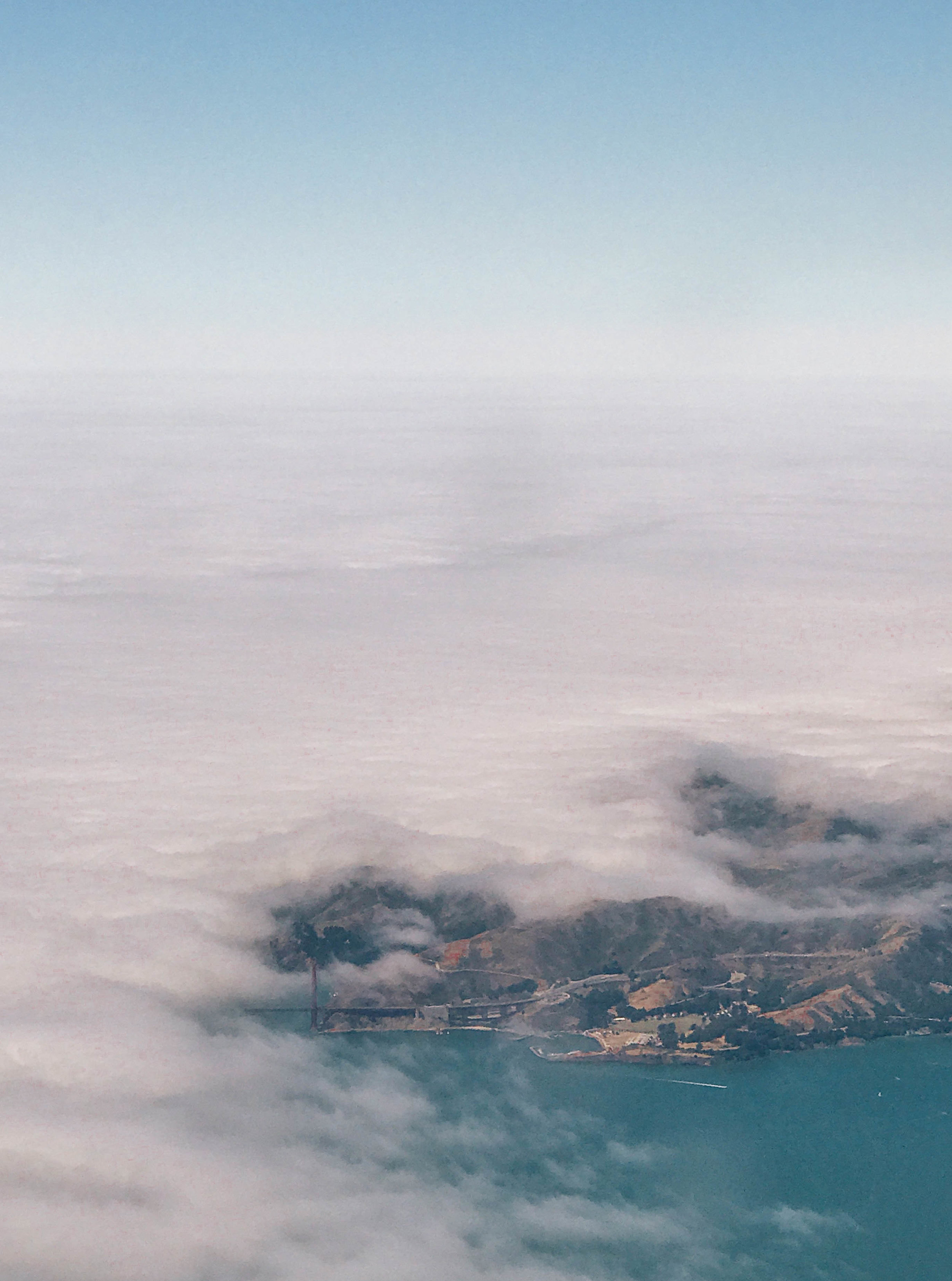 The view from my airplane window. You can just barely see the Golden Gate Bridge peeking out from the fog. So magical!
