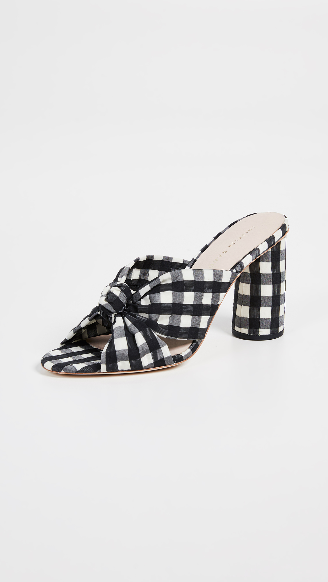 A block-heel sandal - This sandal would be perfect with a pair of white, wide-leg jeans and a denim jacket—a simple and effortless look!