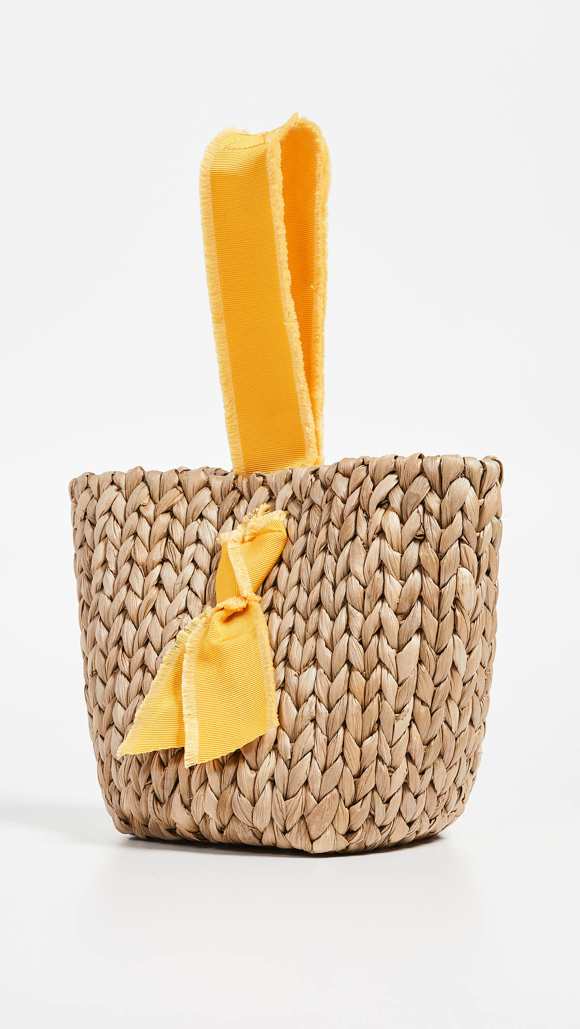 A basket bag - I love the bright pop of yellow on this petite, straw bag—the perfect size to store all your summer essentials from day to night!