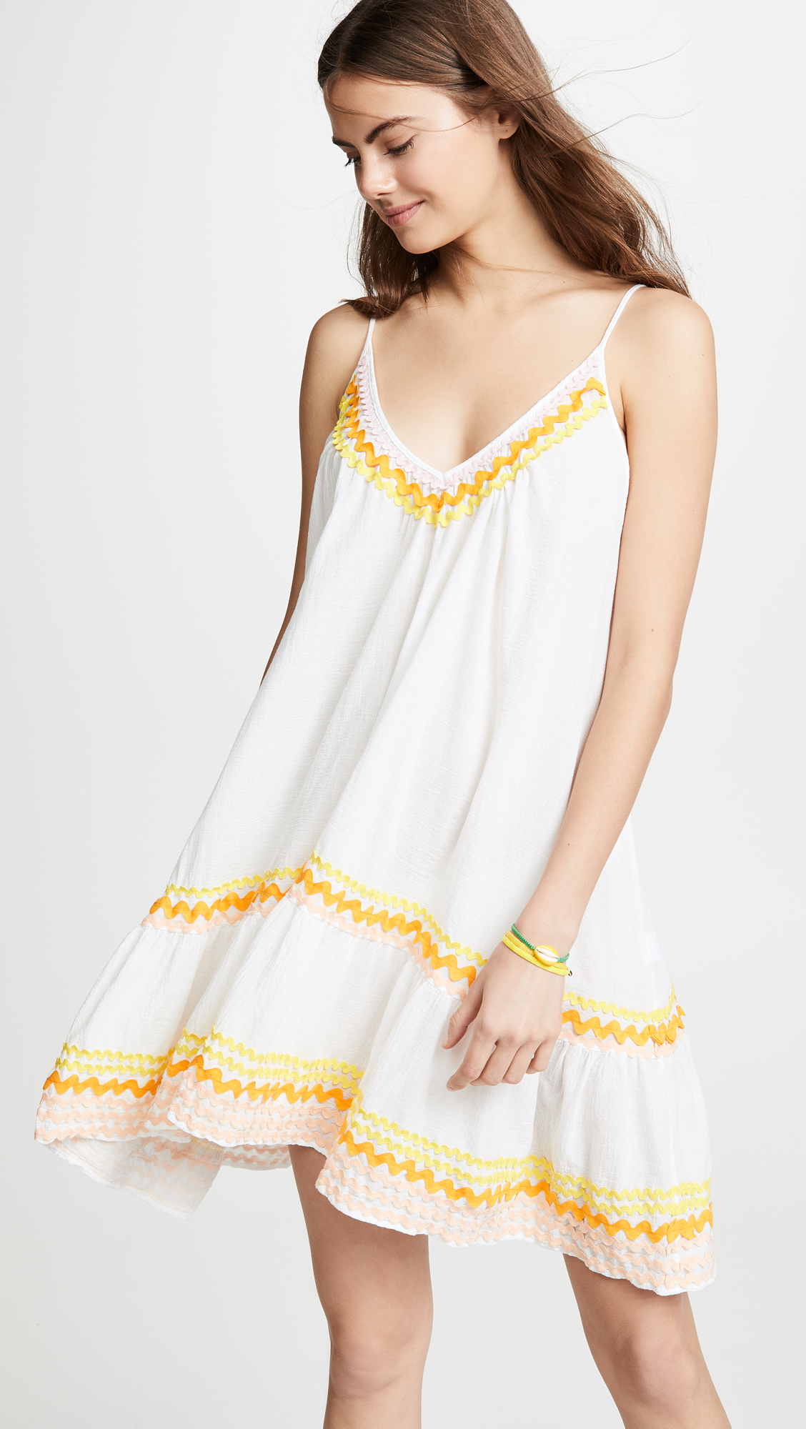 A Flowy Summer Dress - Whether you're poolside or spending the day at the beach, this dress-meets-cover-up is the perfect piece to make you look put-together while having fun in the sun.