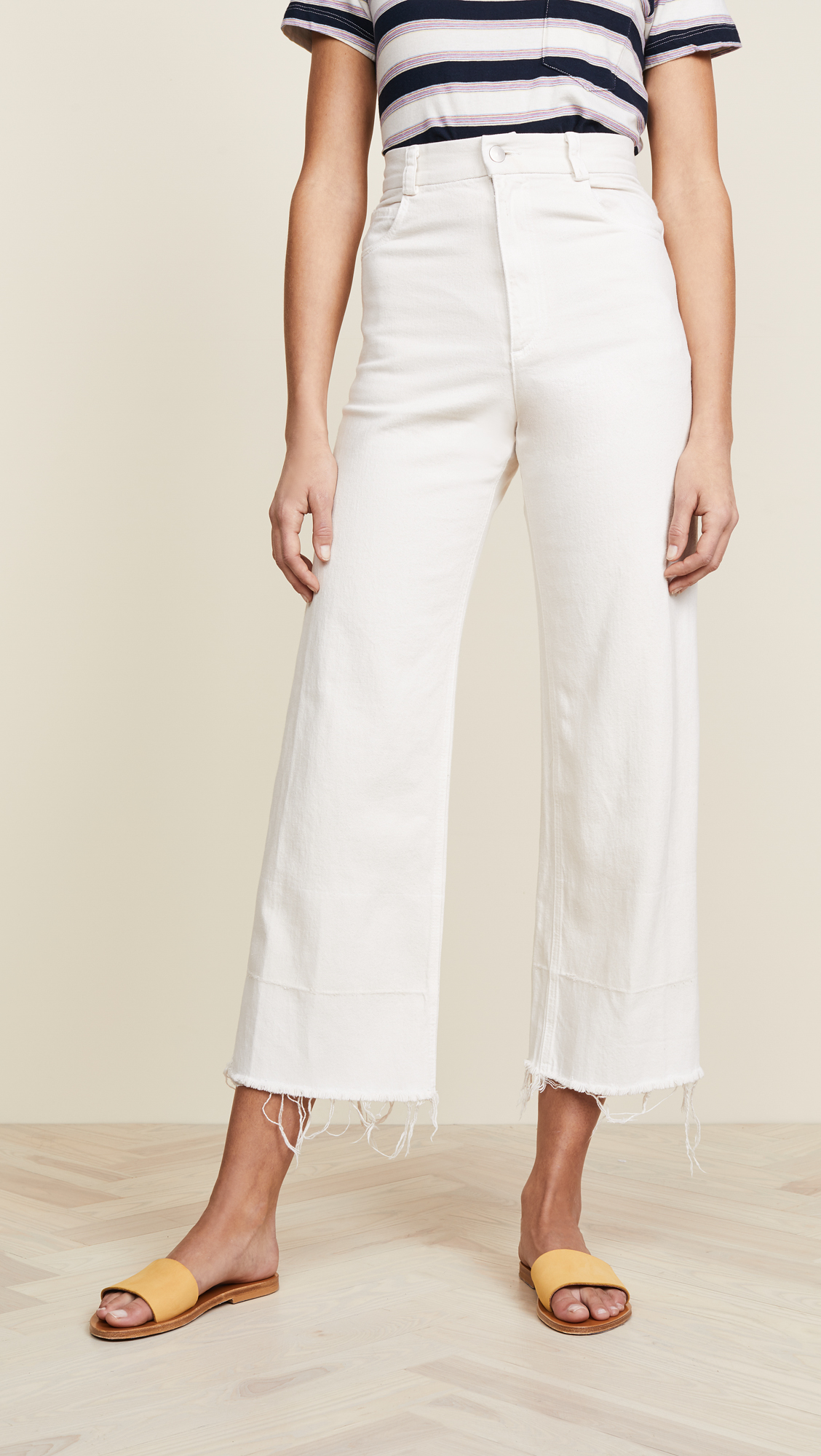 White Cut-off Jeans - One of my favorite summer staples is a pair of white jeans. I love the updated, relaxed look of these with the wide-leg flare and cut-off hem.