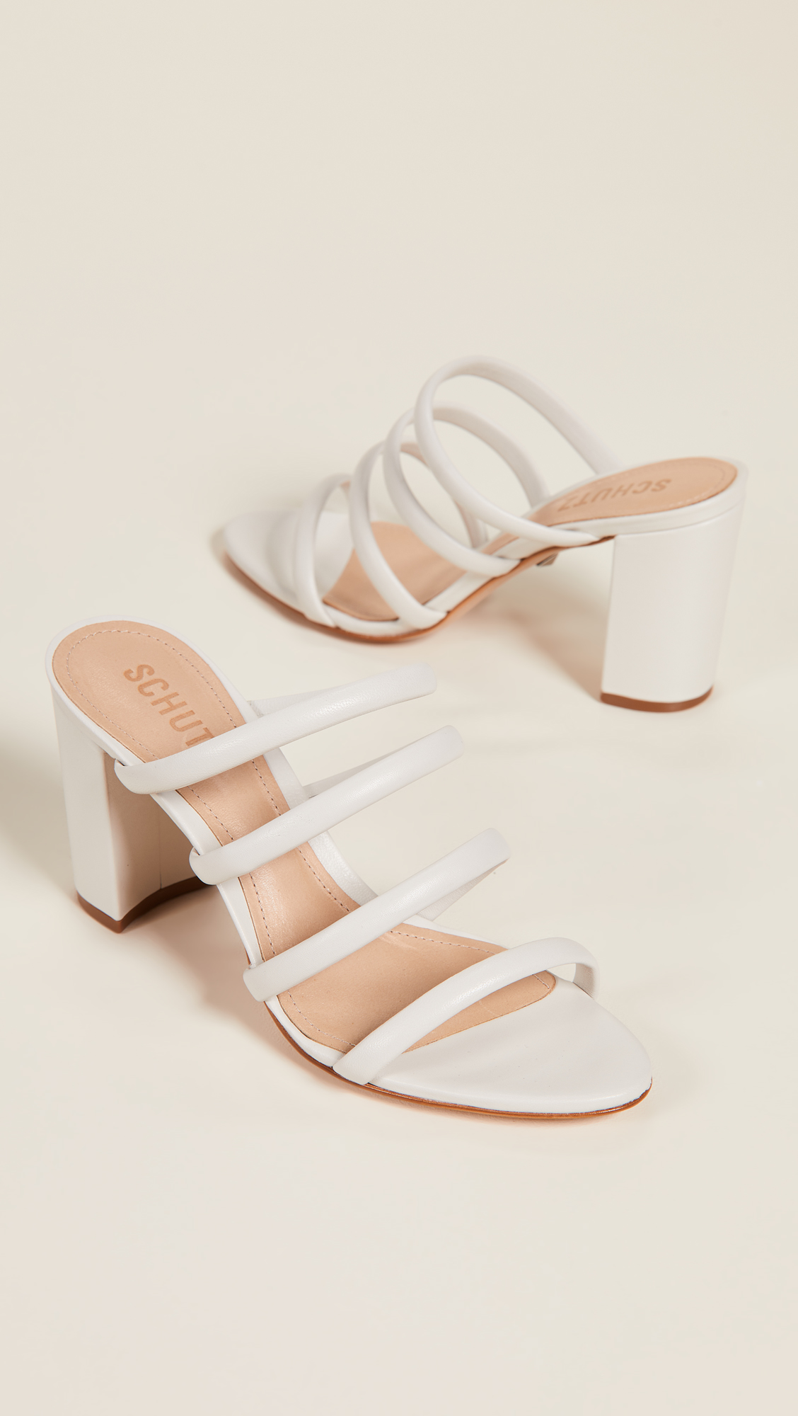 A Strappy Block Heel - My ideal summer sandal in a neutral shade that's easy to slip on! Pair these with your favorite jeans during the day, or slip them on with a dress for a night out!