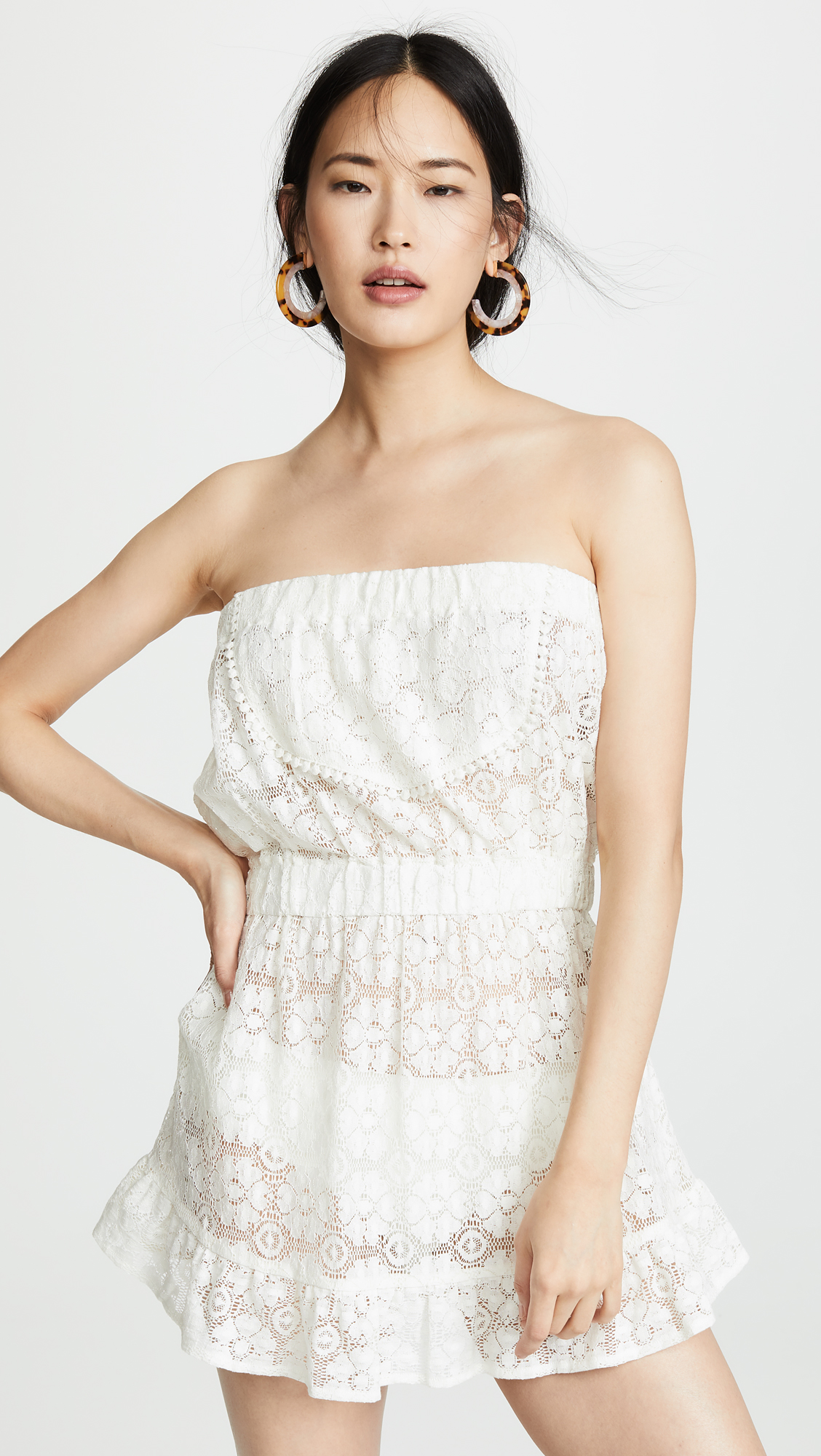 A Lace Cover Up - This is perhaps my favorite cover up I've ever laid eyes on! It's so elegant yet playful all at once—a beautiful piece to take you from the beach to lunch on the patio.