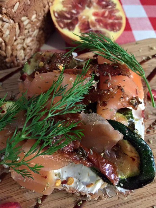 A Frazer 'special open sandwich' - Sunflower Rye bread with cream cheese, grilled courgettes, smoked salmon, dill and pomegranate