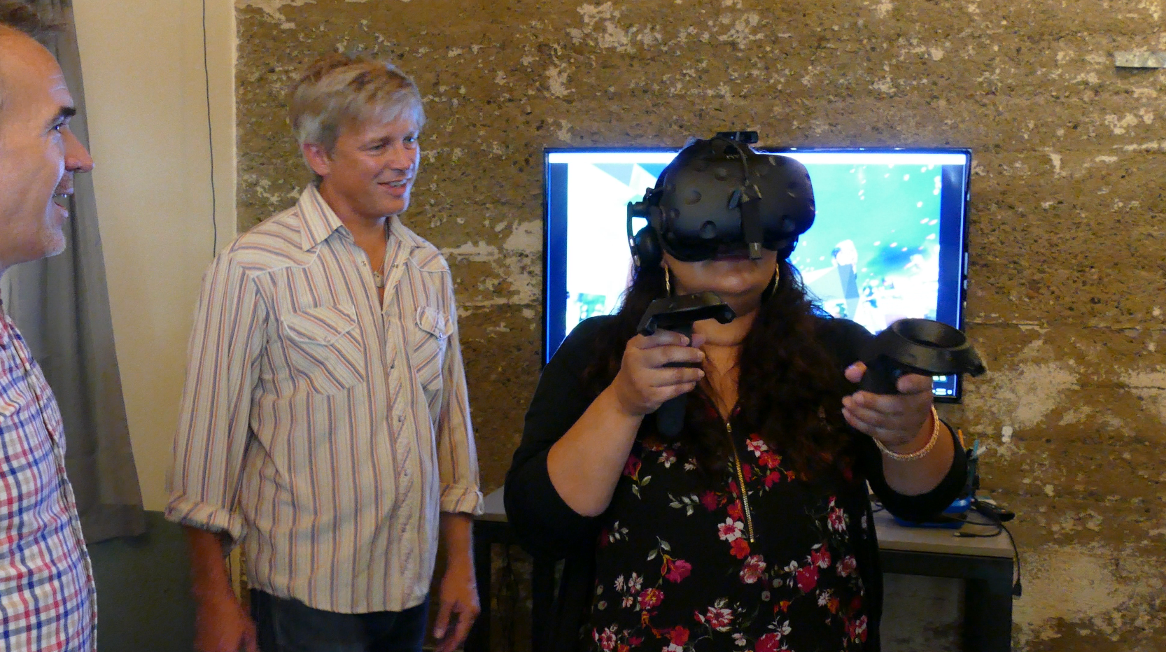 second life founder philip rosedale looks on as caregiver cecii tries social vr [high fidelity in this case] for the first time...