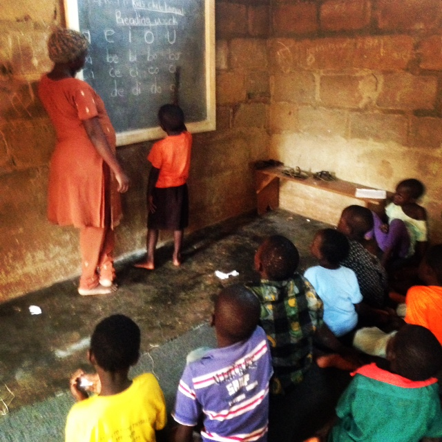 Children learning to read at the Encouraging Education Project.