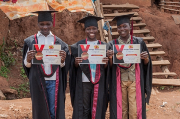 Jacob* (far right) on his graduation day in 2017.