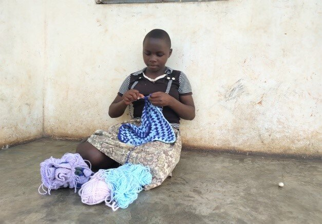 Sophie at the Ewafe home doing some knitting.