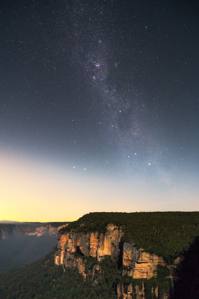 This was taken from Govetts Leap lookout in the Blue Mountains, under the light of a half moon. To help reduce the noise in my astrophotography, I generally take about 10, 13 second exposures at around f4 and iso 3,200, and then combine these back on the computer, using a median stack mode in Photoshop. This helps to minimise the random variations in noise at the higher iso levels required in astrophotography.