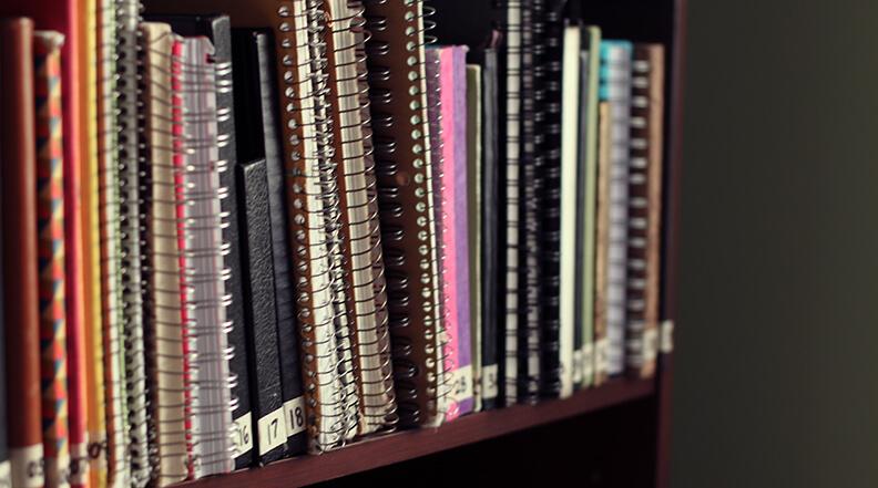JournalsOnBookshelf