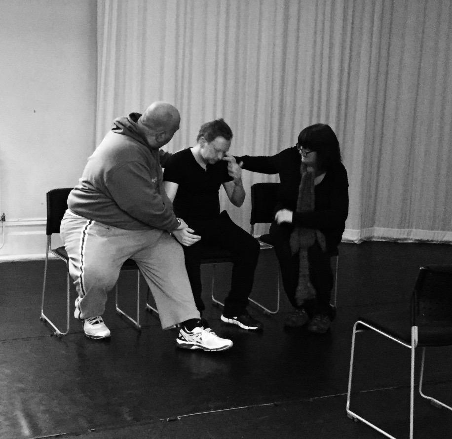 Three actors devise an emotional scene