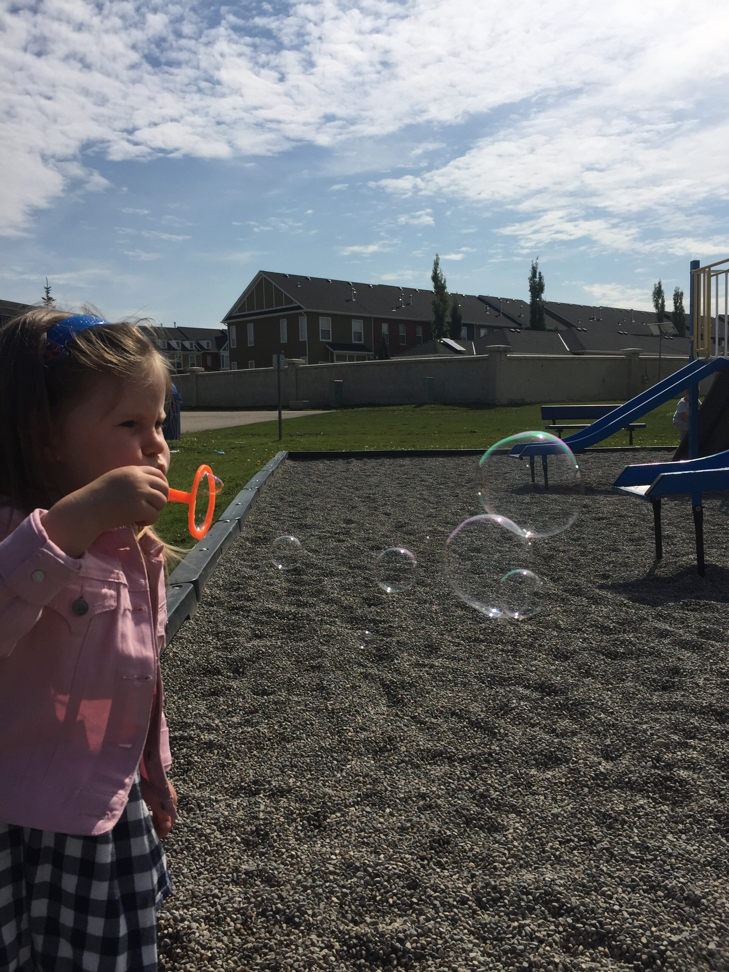 LR Kids Evelyn Outside Bubbles.jpg