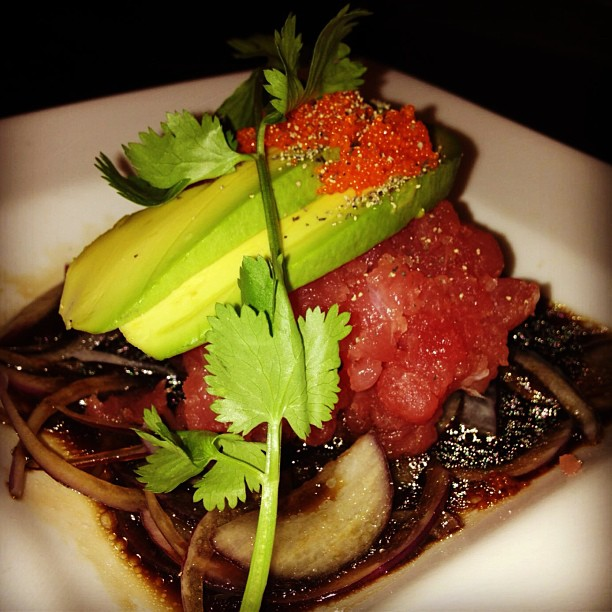Craving something fresh? Try Tuna Tar Tar! Minced tuna on a bed of red onions and balsamic vinegar topped with avocado smelt roe and cilantro!