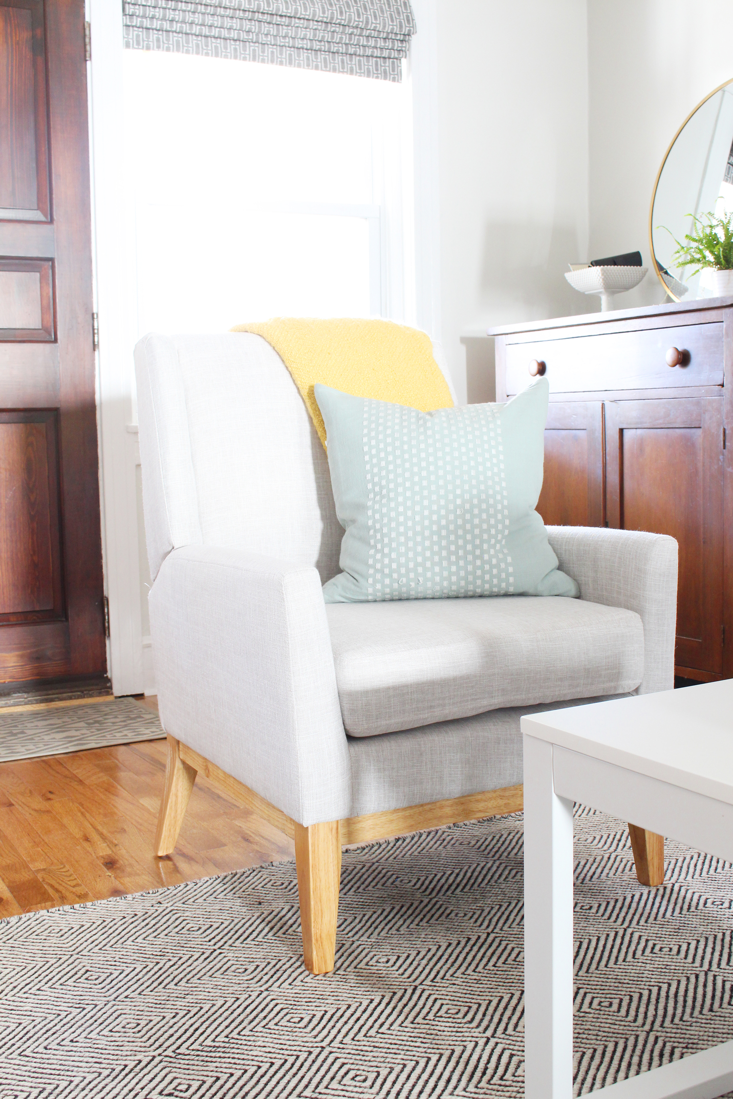 Mid-century style accent chair in gray