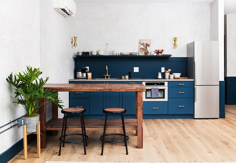 """The Lokal Hotel in Philadelphia. Cabinet paint color: """"Seaworthy"""" by Sherwin Williams."""